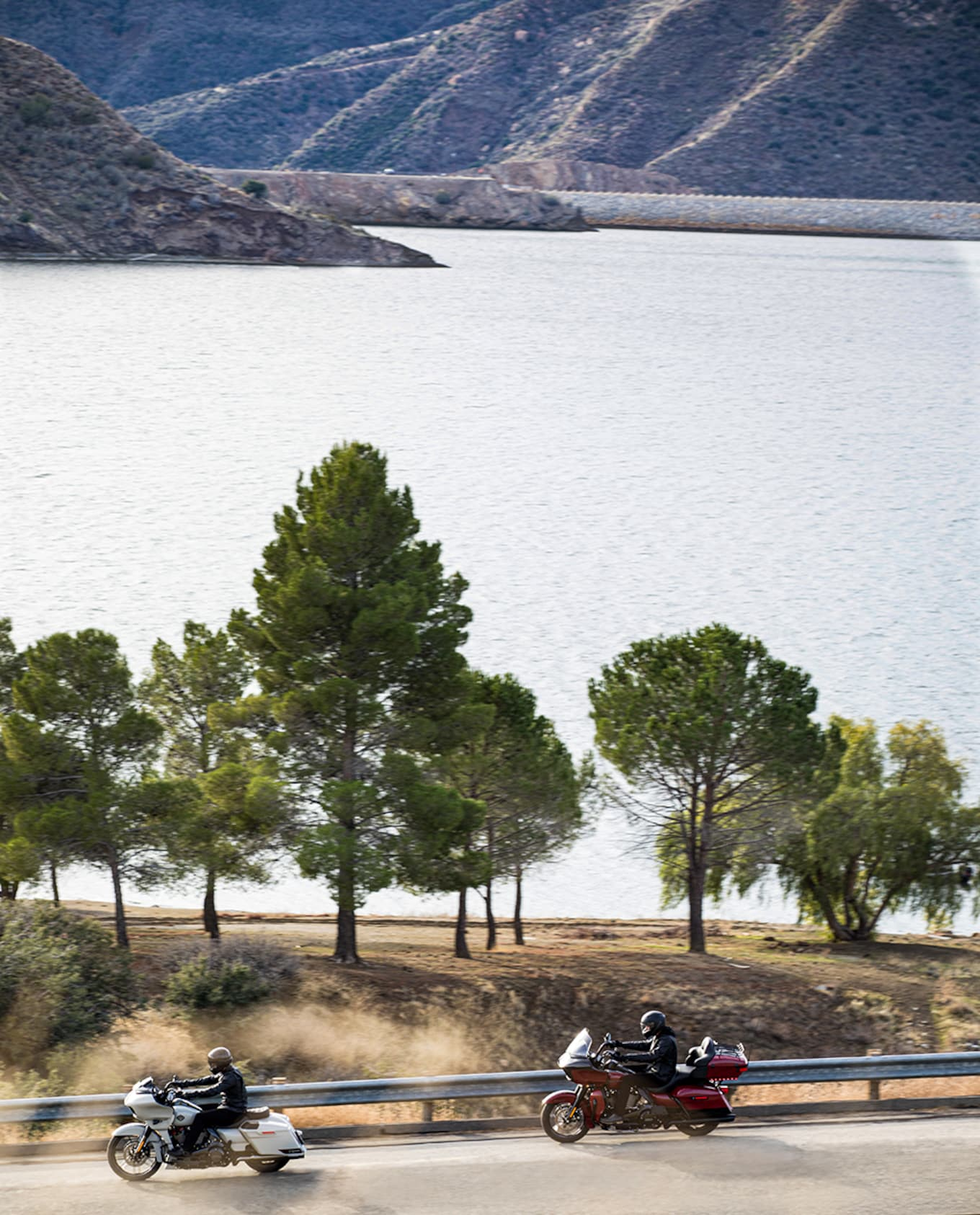 touring motorcycles riding near lake