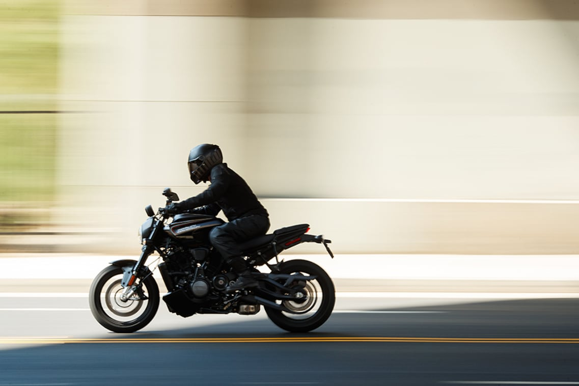 An H-D Bronx street fighter motorcycle passes in a blur.