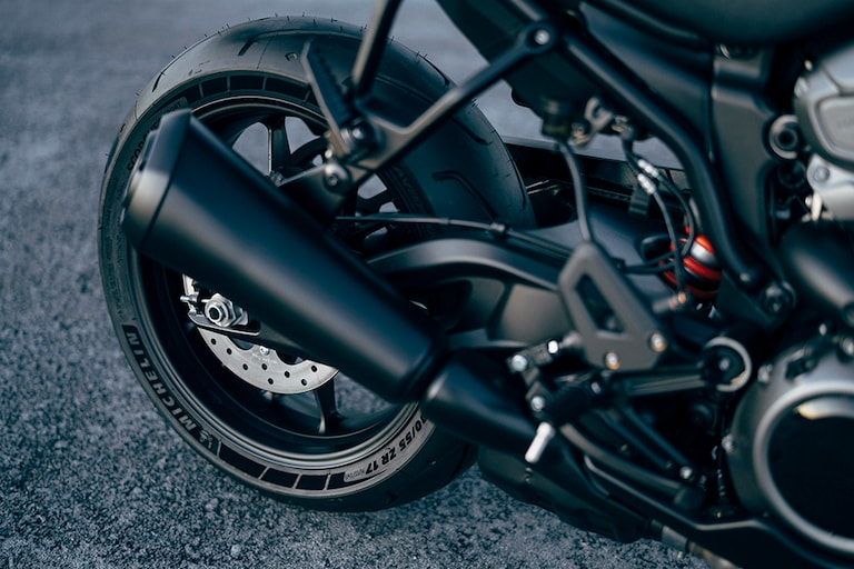 Dramatic, flared exhaust and rear wheel of the Harley Bronx.