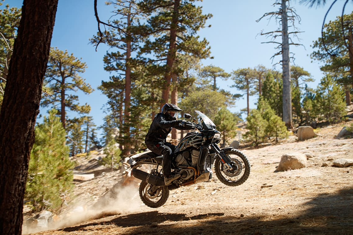 The Harley-Davidson Pan America leaps over rocks
