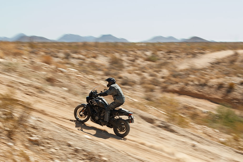 Rocketing up a trail on a H-D Pan America adventure bike