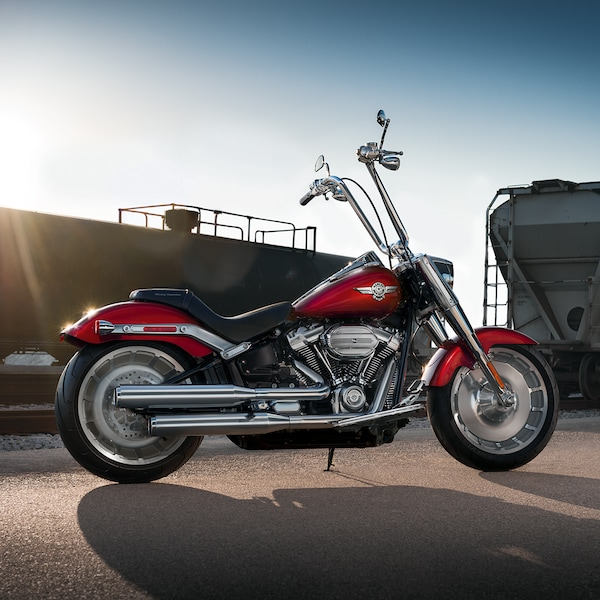 2019 Softail H-D Motorcycle Parked In Front Of A Train