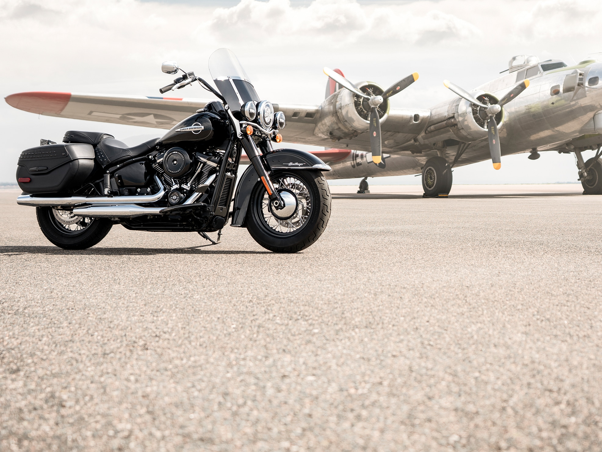 2019 H-D Softail motorcycle Parked in Front of a Plane