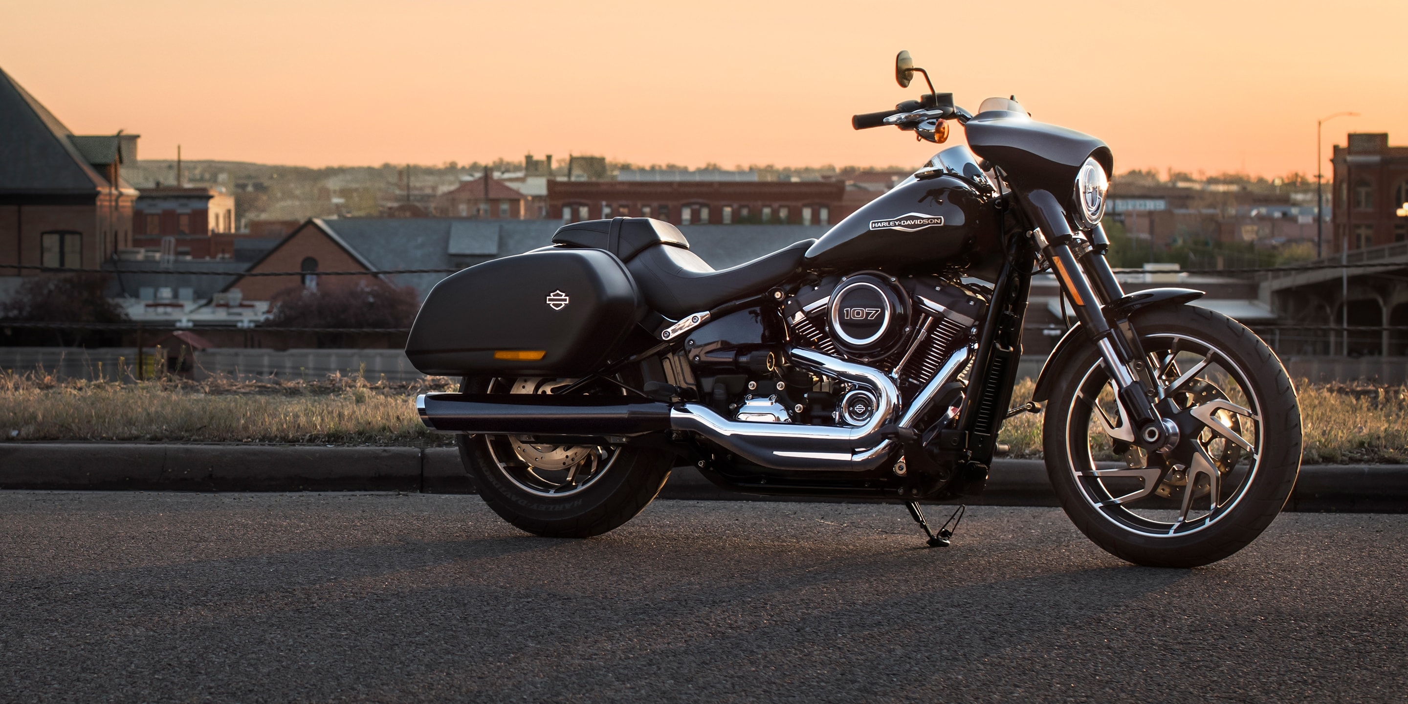 2019 Sport Glide Motorcycle parked in front of skyline