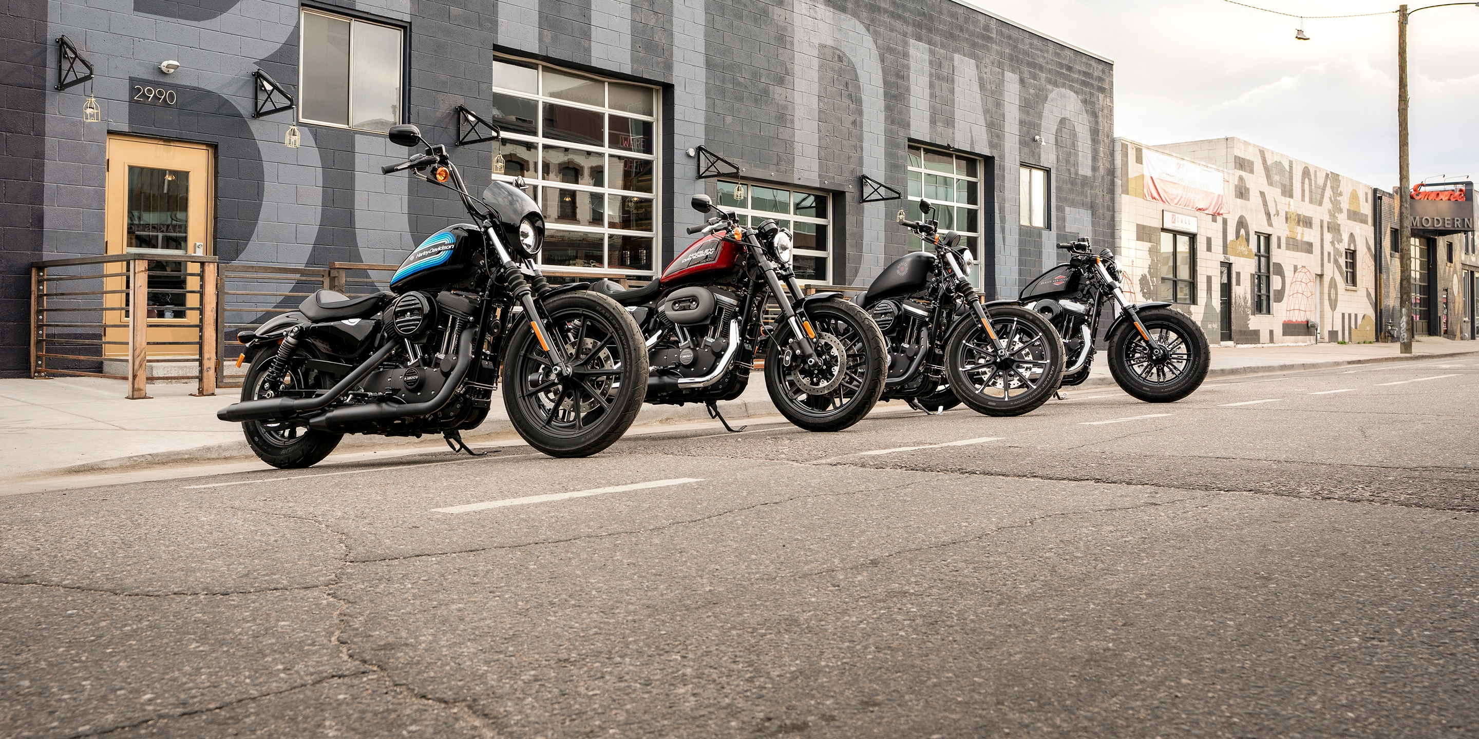 2019 H-D Sportster Motorcycles parked in front of a building