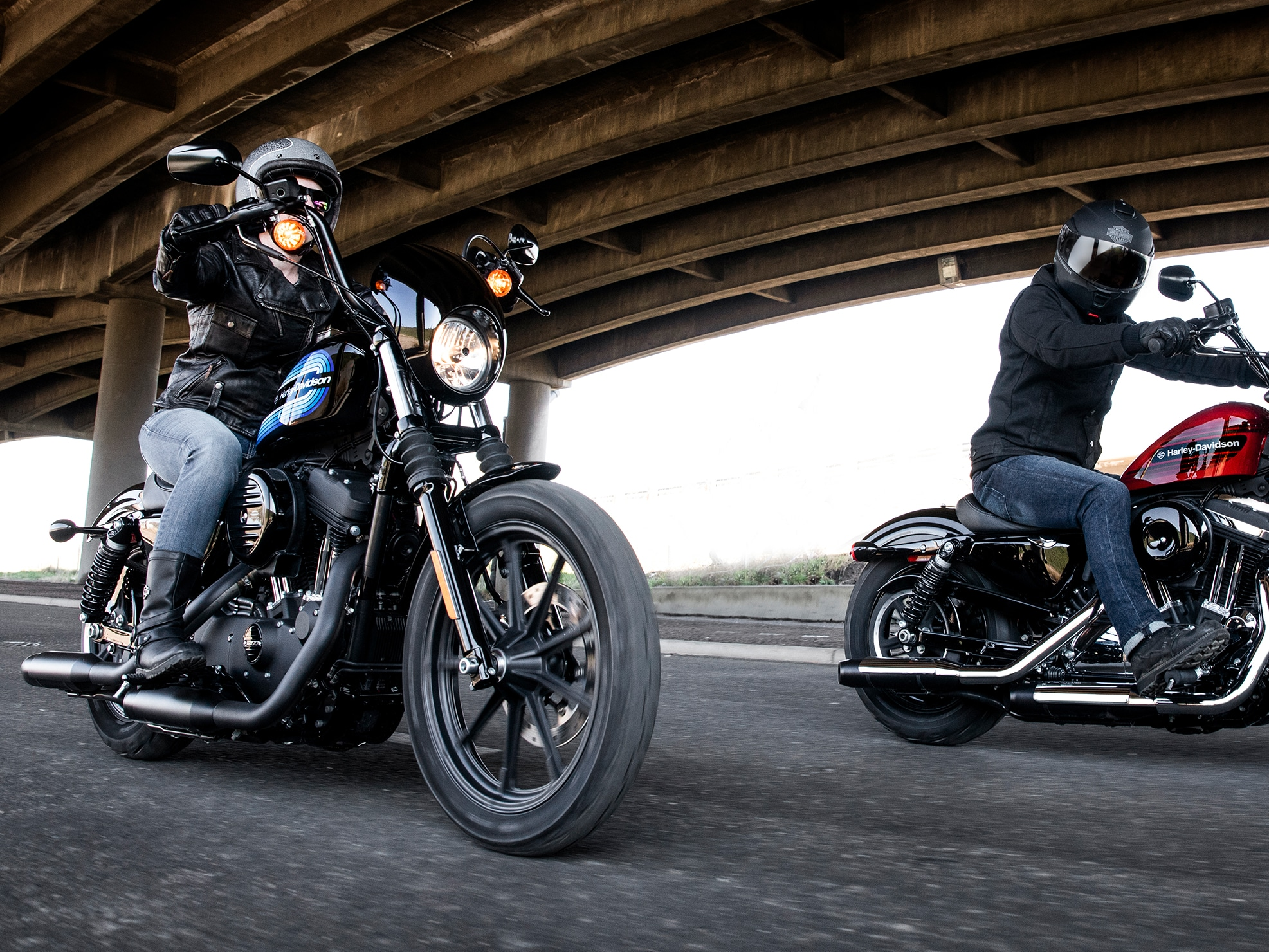 Men Riding 2019 H-D Sportster Motorcycle