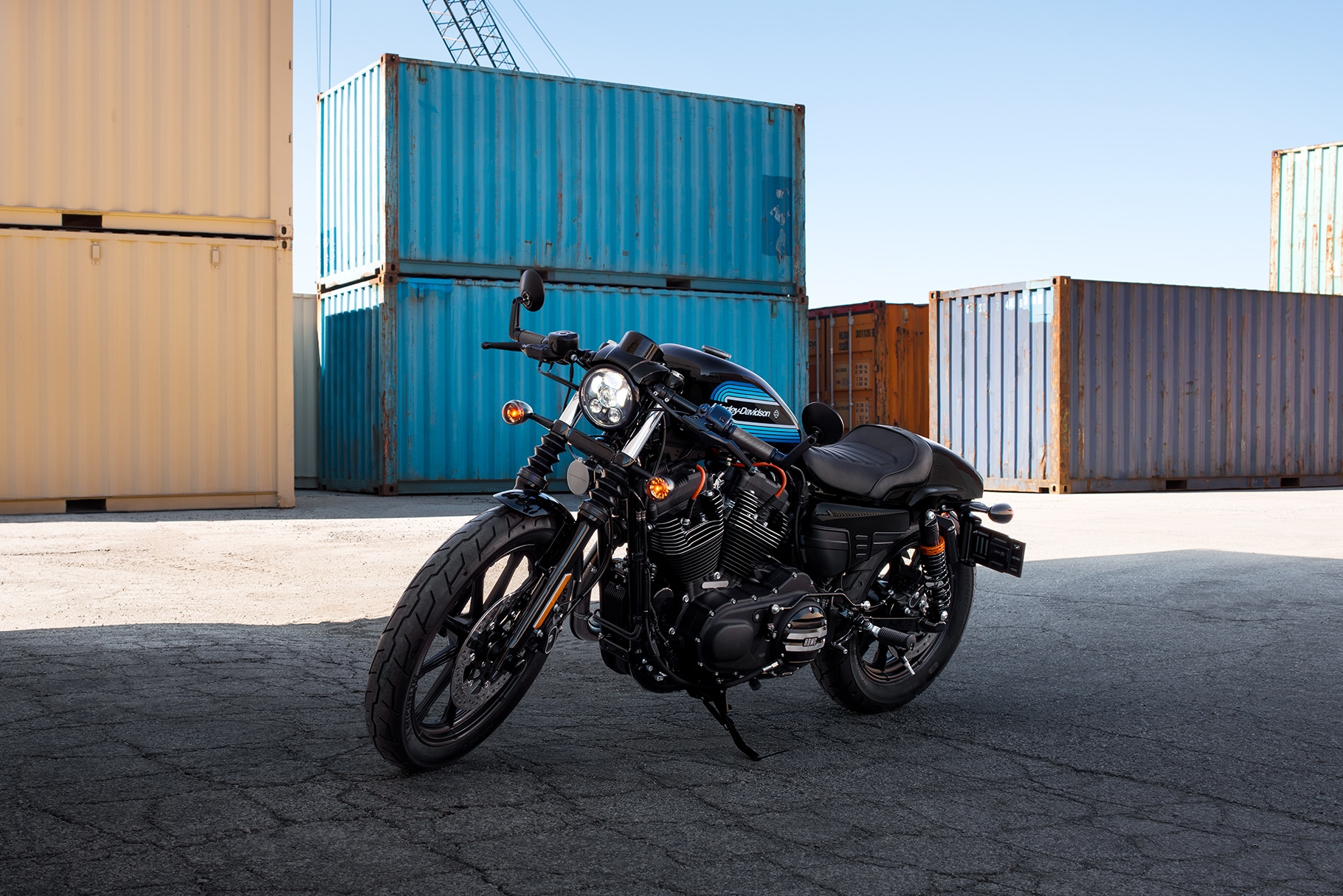 2019 Harley-Davidson Iron 1200 motorcycle parked at a loading dock