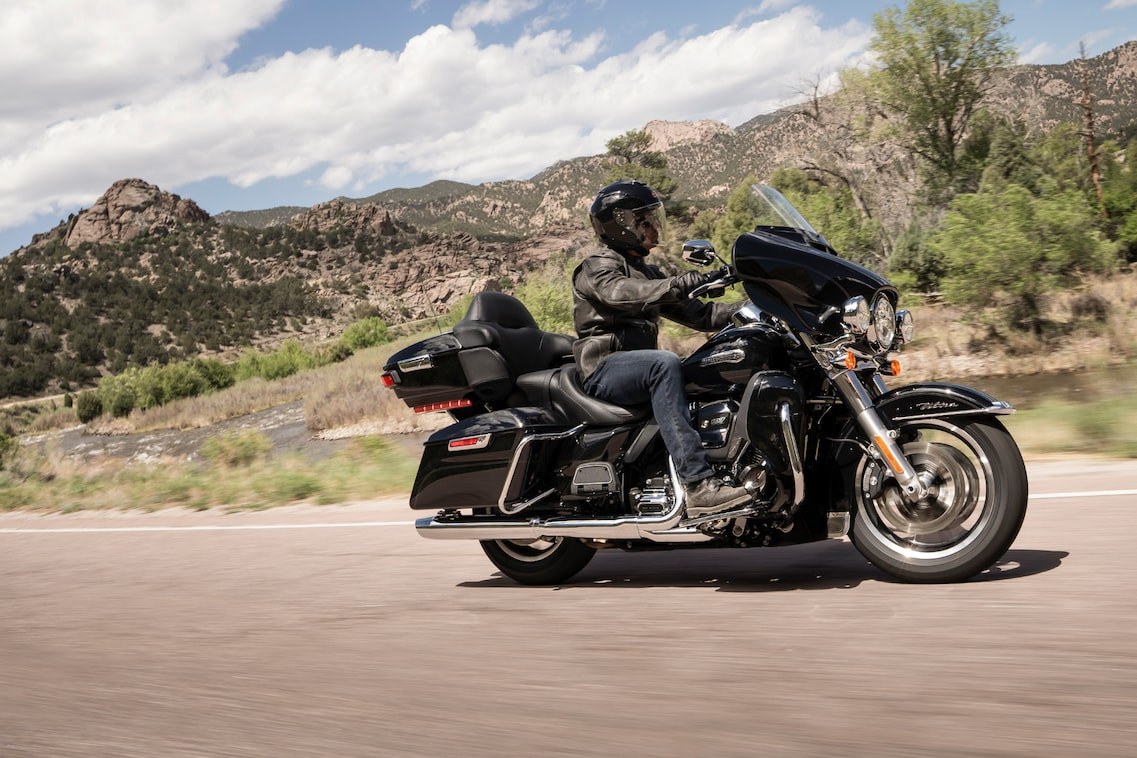 Man riding 2019 Electra Glide Ultra Classic motorcycle through mountain  roads