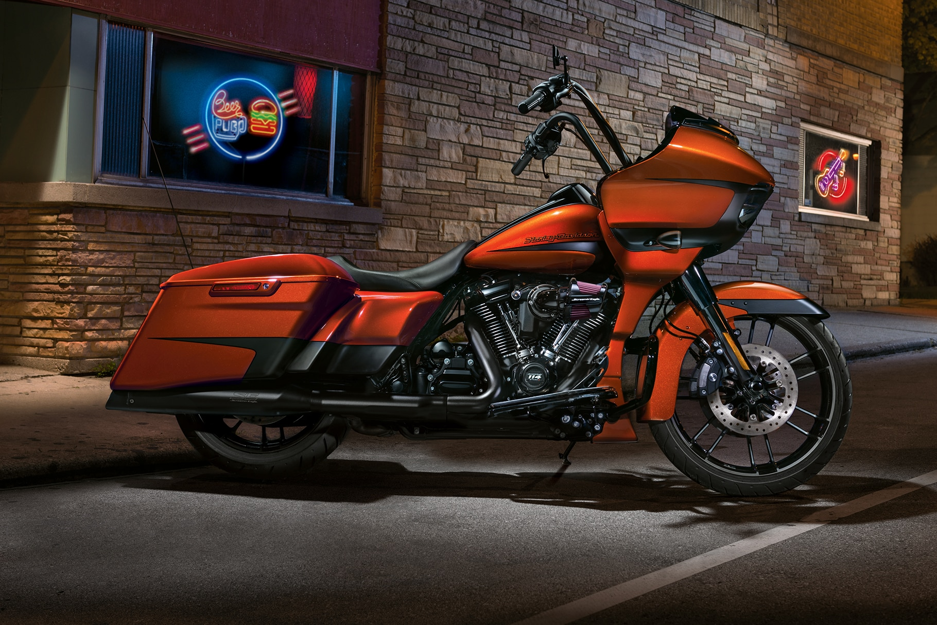 2019 Touring H-D Motorcycle Parked In Front Of A Wall