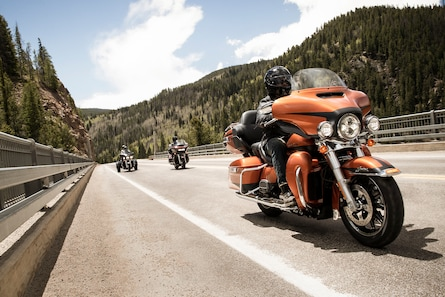 Men Riding 2019 Touring Harley-Davidson Motorcycles on A Highway