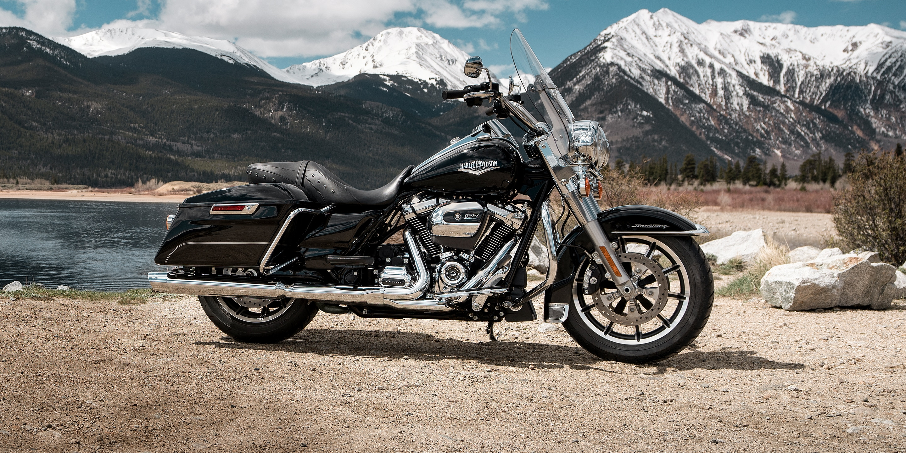 2019 Road King motorcycle parked by mountain scenery