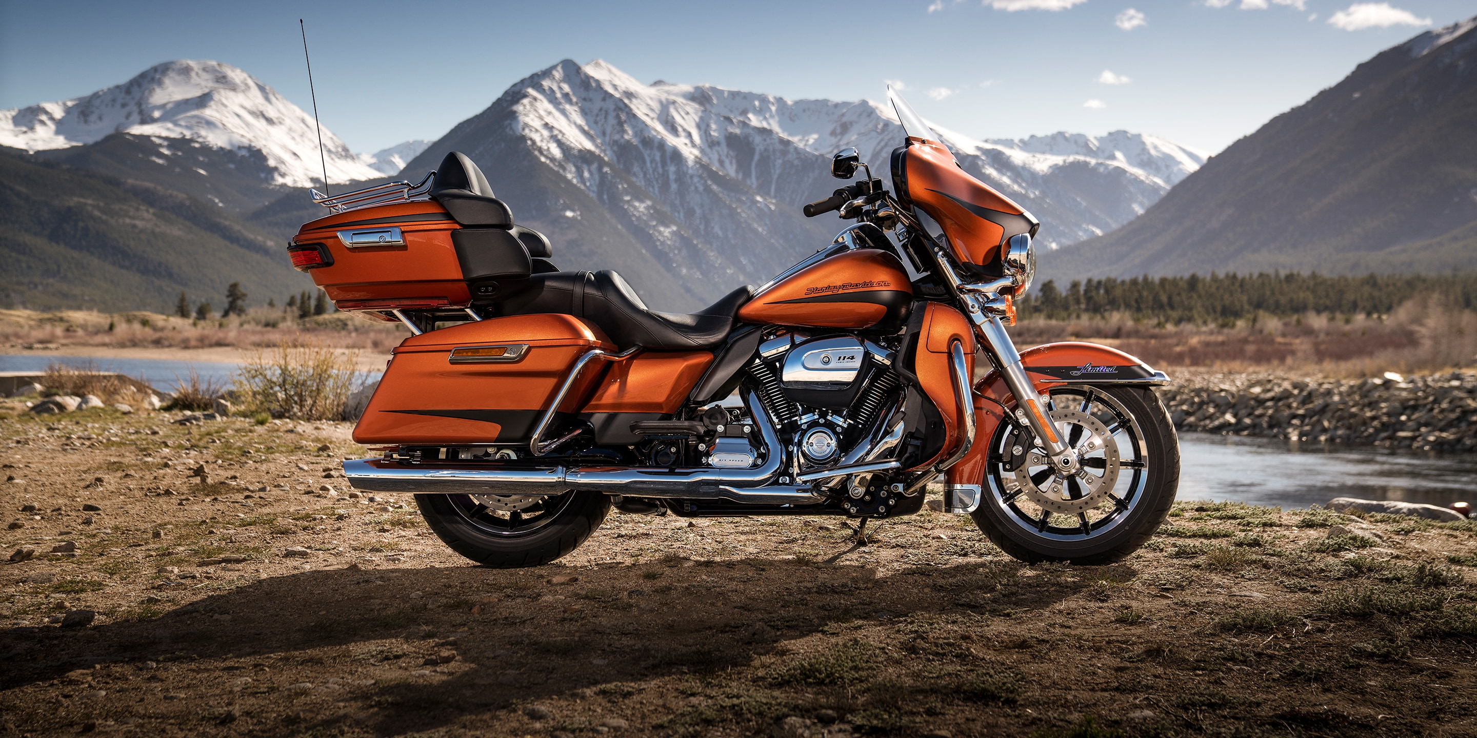 2019 Ultra Limited motorcycle parked by mountain scenery