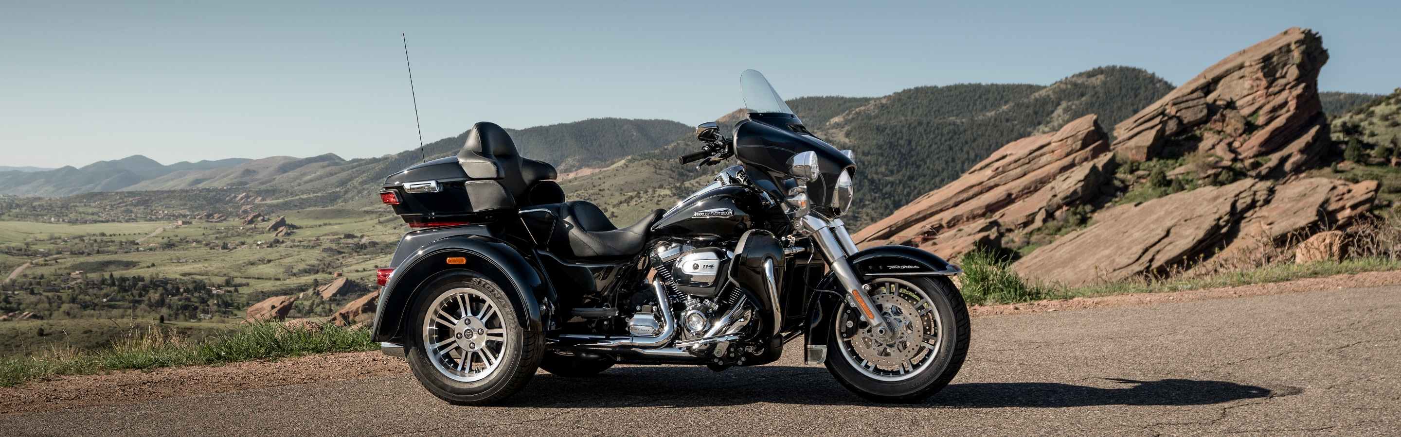 Men Riding 2019 Trike H-D Motorcycle