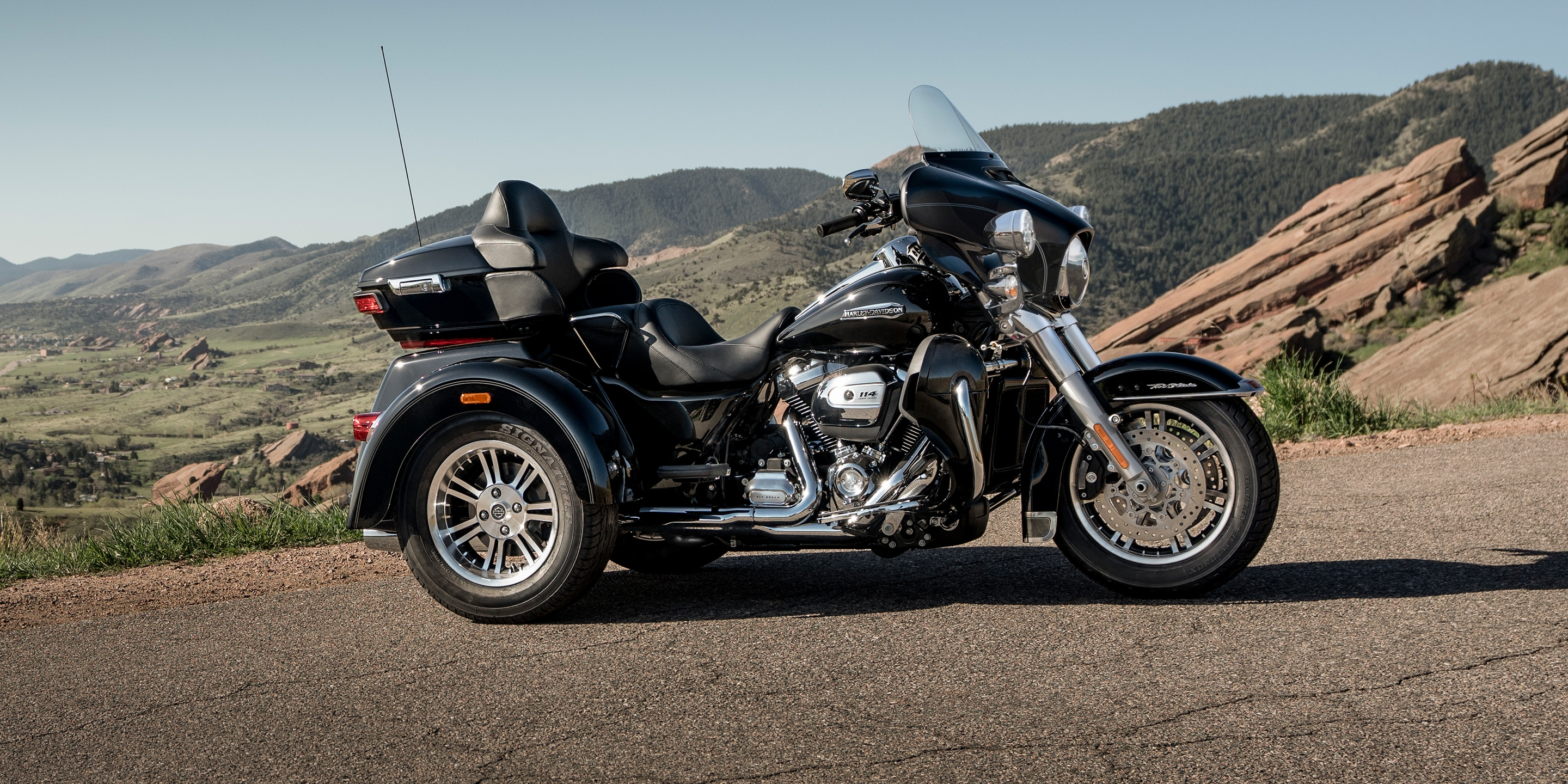 2019 Tri Glide Ultra motorcycle parked by mountain scenery