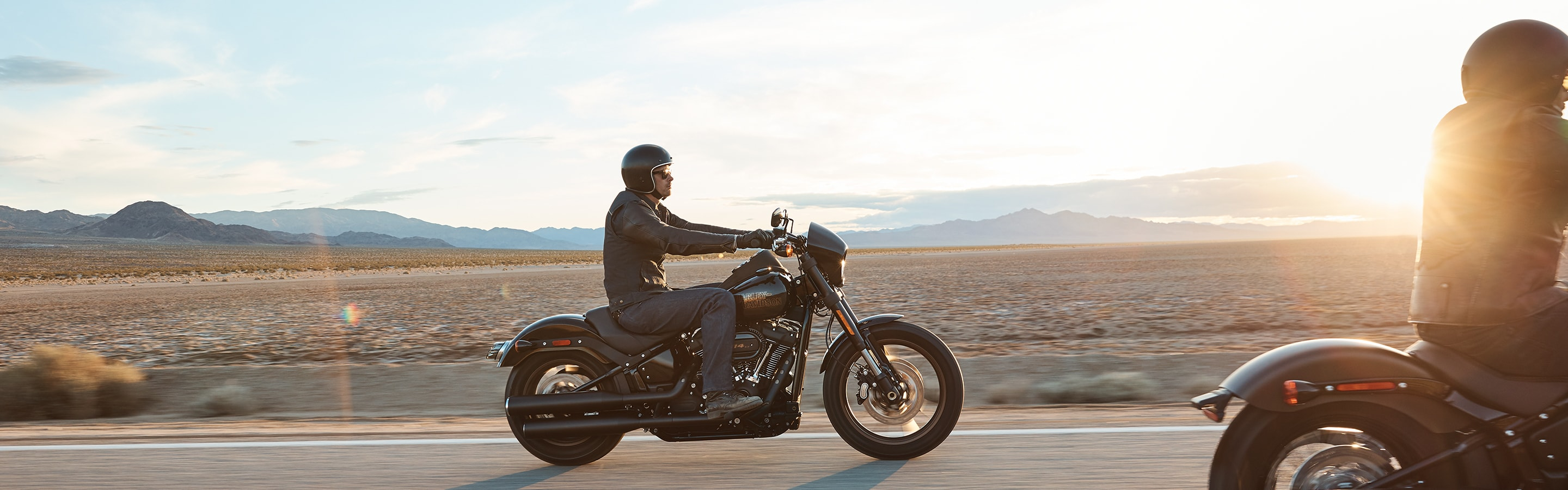 Man Riding 2020 Harley-Davidson Softail motorcycle