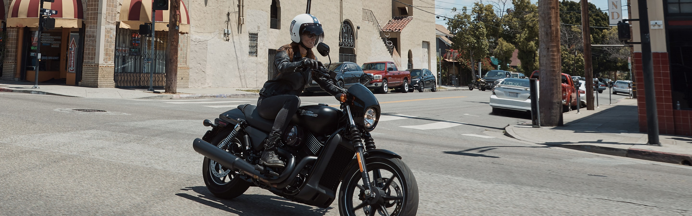 A Woman riding a 2020 H-D Street Motorcycle