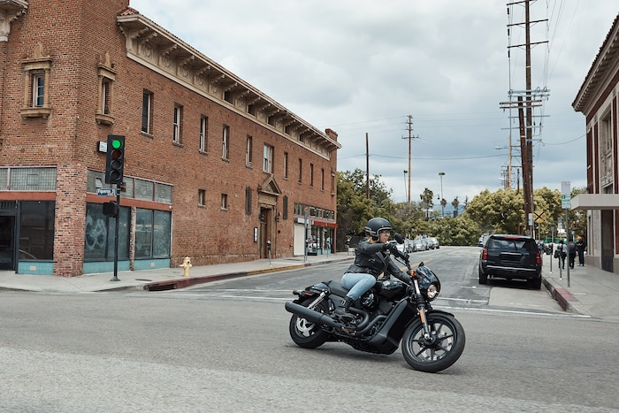 Man riding a 2020 H-D Street motorcycle