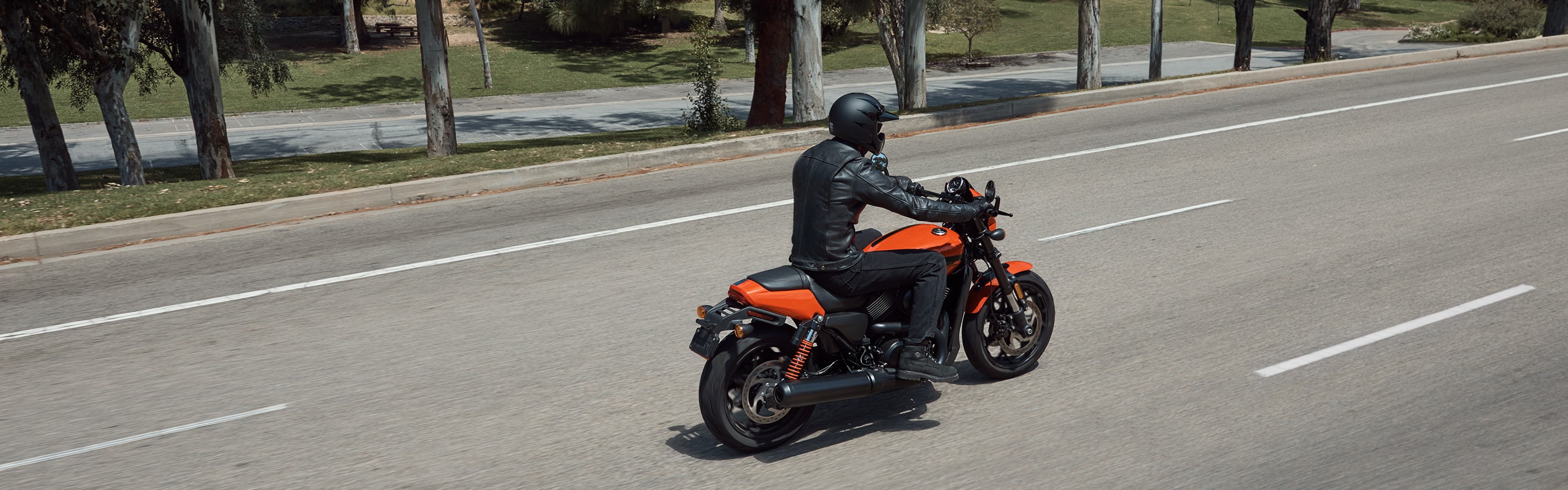 Man on a 2020 Street  H-D motorcycle standing at traffic lights