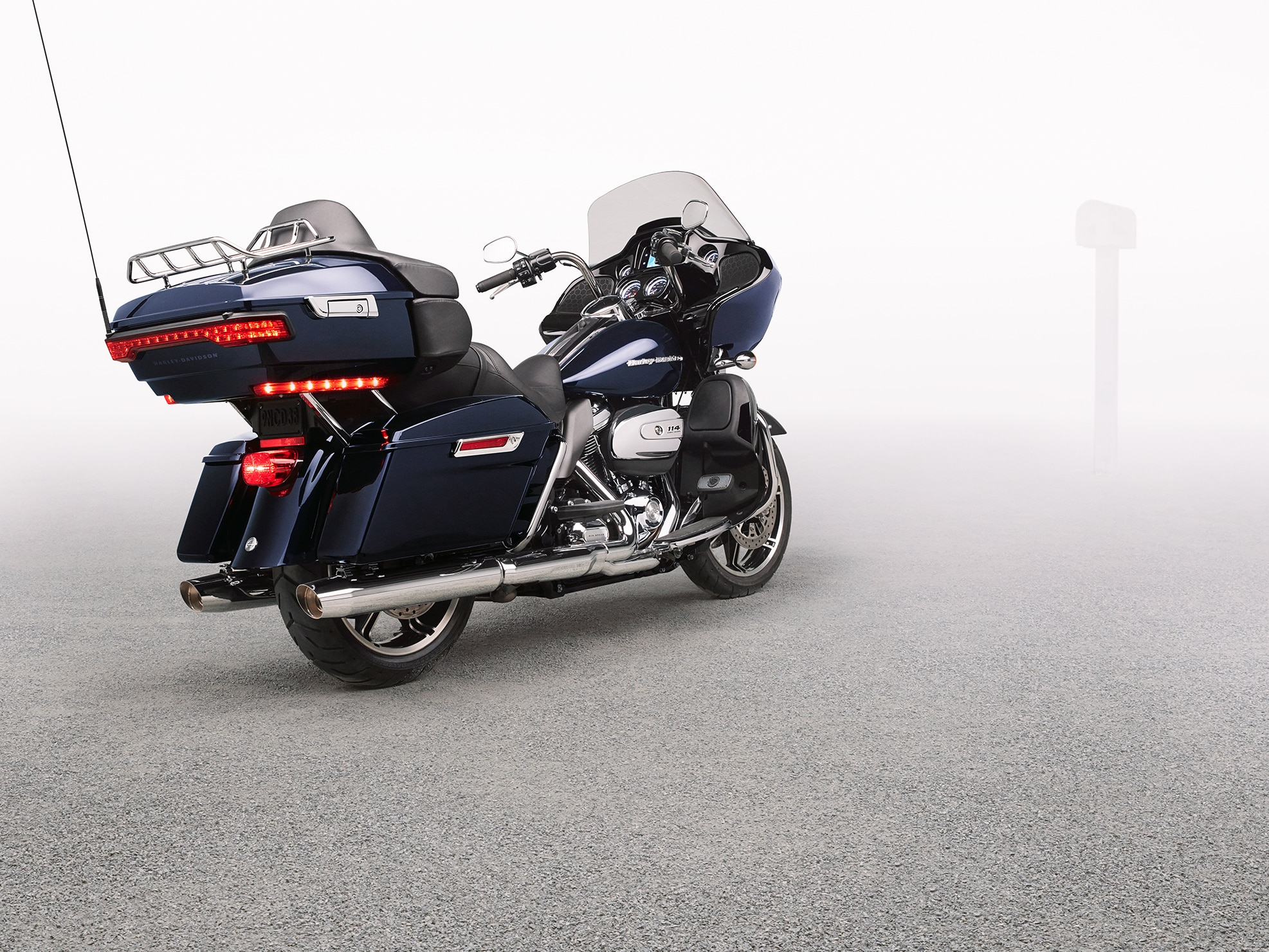 Man Riding 2019 Touring H-D Motorcycle on the Road